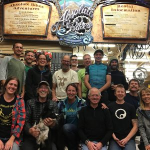 The staff of Absolute Bikes in Salida, Colo. Owners Shawn and Dena Gillis are on the bottom-right. The rural business owner talks about his city morphed its struggling business climate into a popular outdoor destination and diversified its economy.