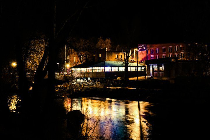 Night photo of the outside of the Bouthouse Cantina. In this episode, we talk with a Rural Business owner in Salida, Colorado on how the Arkansas River ties the community together.