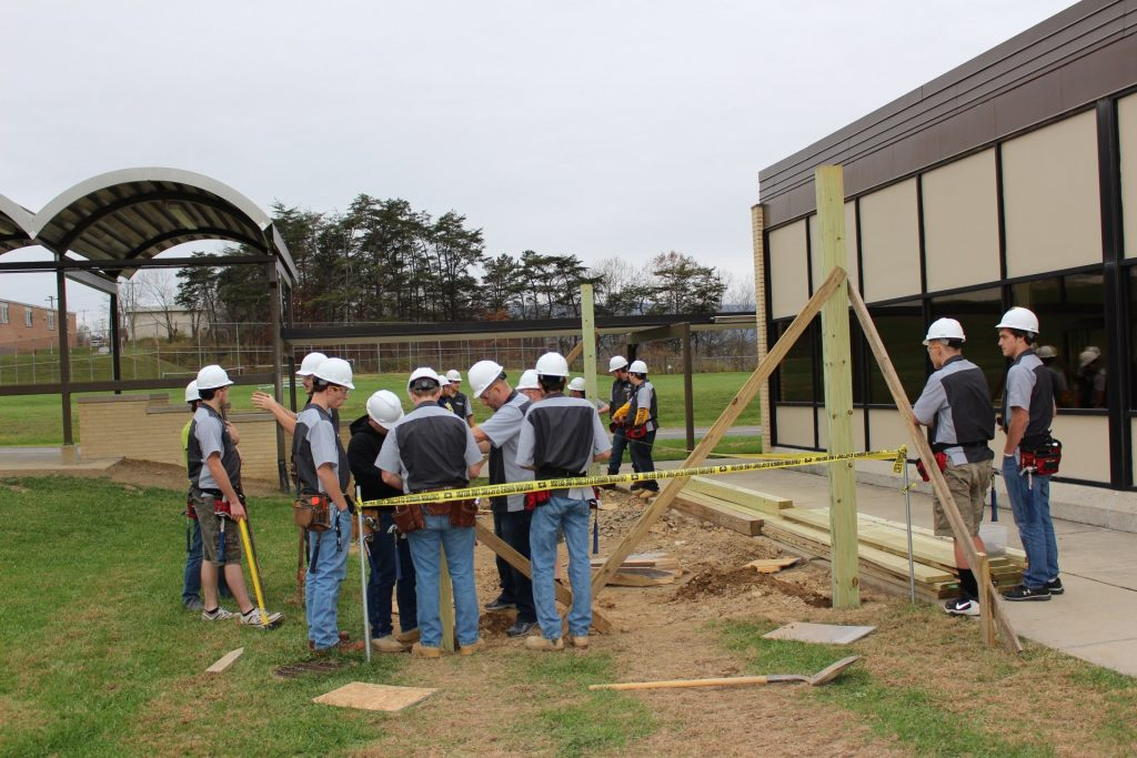 A group of West Virginia students working at a construction site as part of a Simulated Workplace curriculum.